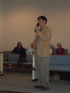 Pastor Philip Raines delivers a First Day message during programmed worship